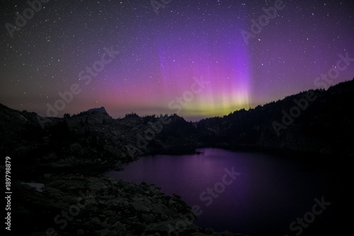 northern lights above mountain lake