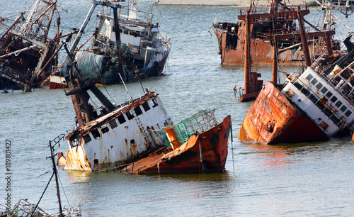 Spoed Foto op Canvas Zuid-Amerika land Abandoneold rusty ships in the Port of Montevideo, Uruguay. Old ship grave yard.