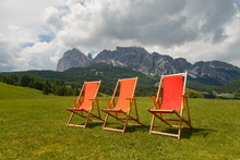 Three Colorful Deck Chairs In ...