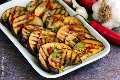 Photo Stands Grill / Barbecue Grilled Marinated Eggplant slices