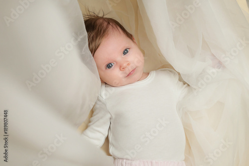 Fotografie, Obraz  Adorable two months old baby wrapped in white fabric