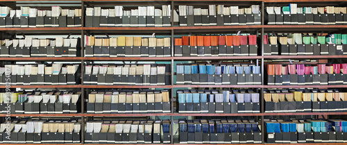 Fotografia  Shelves with old books in a library