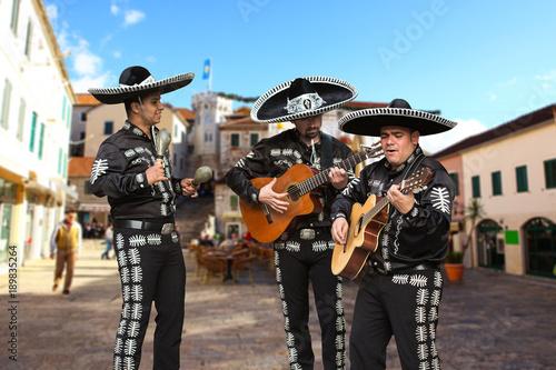 Fotografie, Tablou  Mexican musicians mariachi on a city street