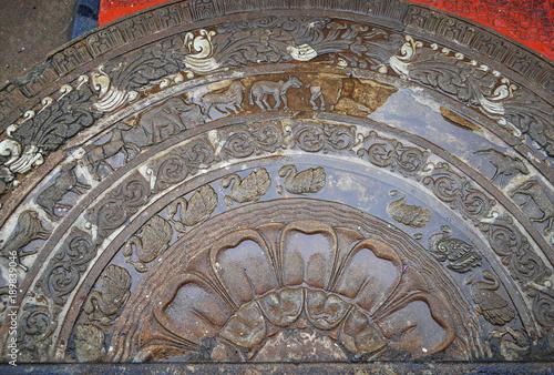Fotografia, Obraz  Moonstone relief depicting the cycle of sansara