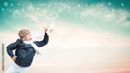 Imagination Inspiration And Creative Learning Motivation Concept With School Girl Child In Pilot Costume Having