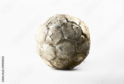 Damaged soccer ball isolated on white background