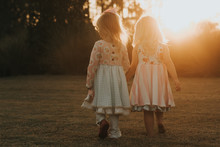 Toddlers Walking Holding Hands