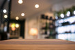 Empty wooden table and blurred background of abstract in front of restaurant or coffee shop for display of product or for montage
