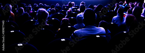 People in the auditorium watching the performance Fototapeta