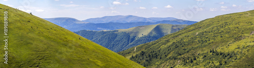 Keuken foto achterwand Heuvel Panorama of green hills in summer mountains