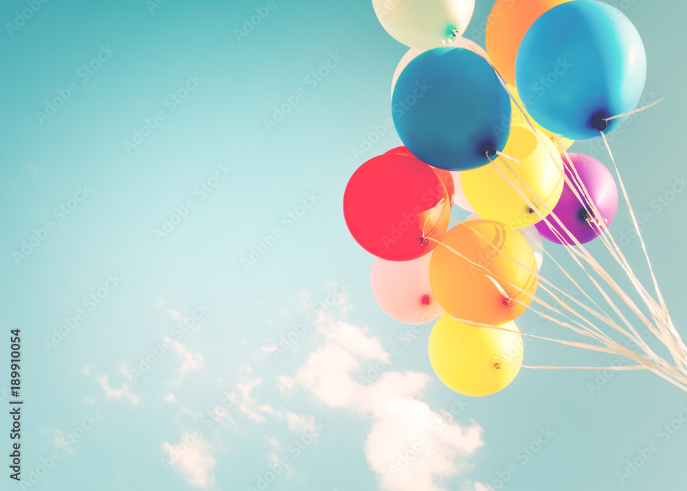 Colorful balloons done with a retro instagram filter effect. Concept of happy birth day in summer and wedding, honeymoon party use for background. Vintage color tone style