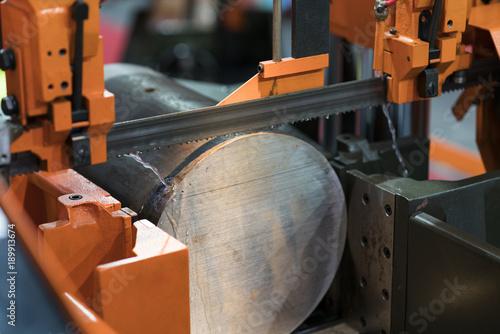 Fotografie, Obraz  band saw cutting steel bar