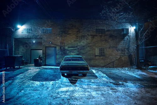 фотография  Vintage muscle car in a dark Chicago city urban alley on a winter night