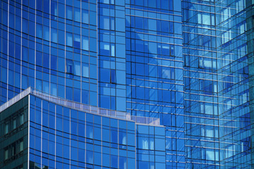 close up on modern office building skyscraper with blue glass wall