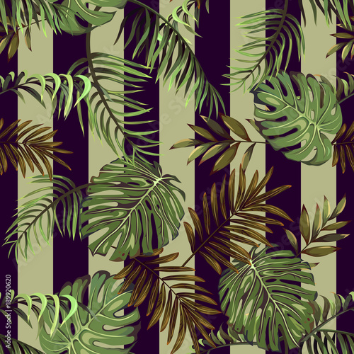 Cotton fabric Seamless pattern with leaves of tropical and exotic plants on a striped background
