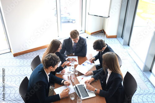 Obraz Business meeting in an office, the businesspeople are discussing a document. - fototapety do salonu