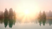 Sunrise At A Lake On A Foggy Morning