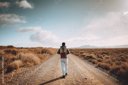 Cheerful man on dry road