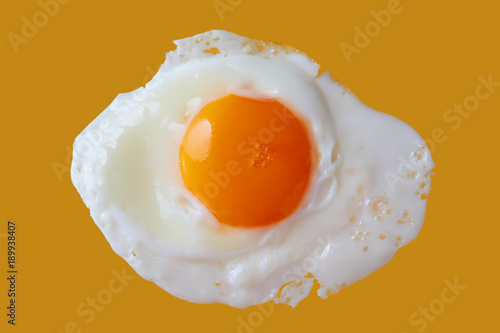 Poster Gebakken Eieren Fried Egg Close-up On Yellow Background