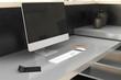 Creative desktop with empty computer