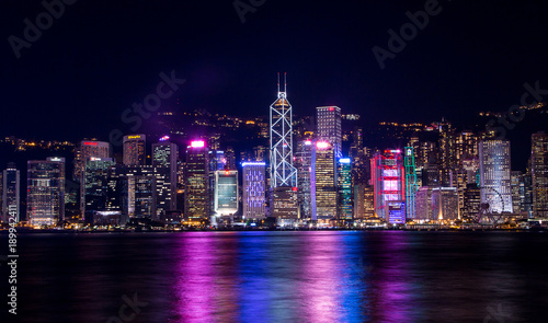 Canvas Prints New York Hong Kong, China. August 30, 2017. Skyline at night with lights and skyscrapers over sea with laser beams.
