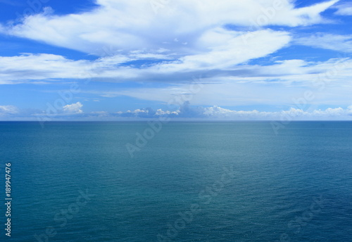 Staande foto Zee / Oceaan Perfect landscape with turquoise water of the South China Sea with shallow ripples on the surface under amazing white clouds.