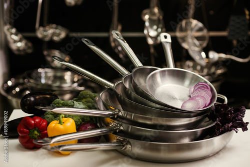 Fotografía  Stack of professional kitchen pans