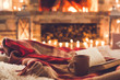 canvas print picture - One cup and a book near the fireplace winter concept