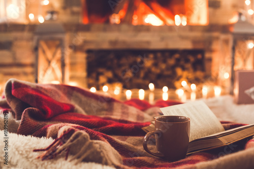 Fotografía One cup and a book near the fireplace winter concept