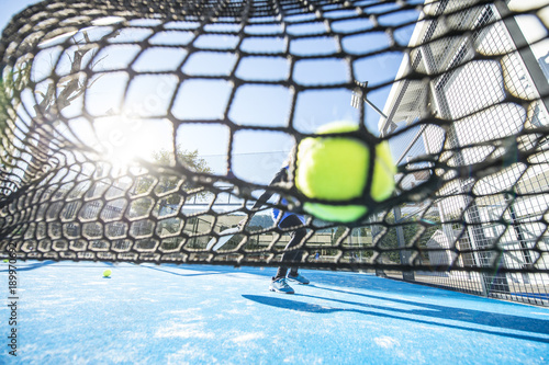 Fotografía  two women 47 years old playing Paddle tennis, Tennis ball at net