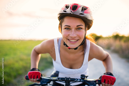 Fotografie, Obraz  funny girl on a bicycle outside the city