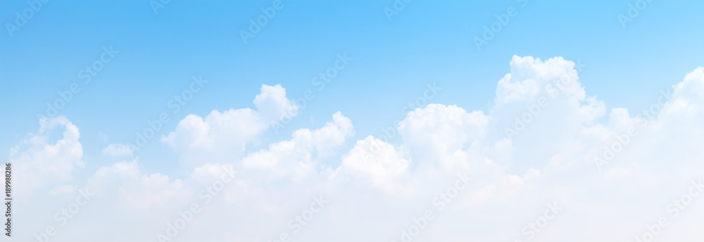 Fototapeta White cumulus clouds formation in blue sky