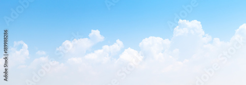 White cumulus clouds formation in blue sky Canvas Print
