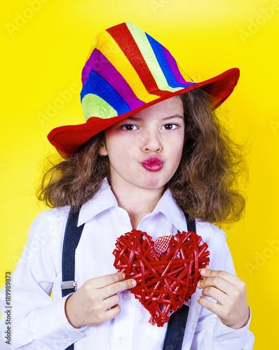 Staande foto Kinderkamer Lovely boy sends an air kiss and keeps the heart