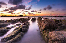 Long Expose Seascape With Leading Lines Rocks Formation