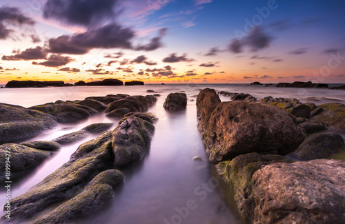 Foto op Aluminium Aubergine long expose seascape with leading lines rocks formation