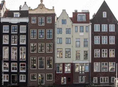 Typical gabled houses on Damrak street in Amsterdam, Holland, Netherlands Wallpaper Mural