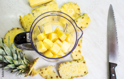 Sliced pineapple in a blender for a smoothie