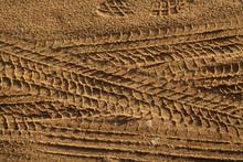 Tyre Tracks On Sand.