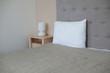 Interior of cozy light gray bedroom in minimalist design