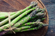 Bunch Of Asparagus On Wooden B...