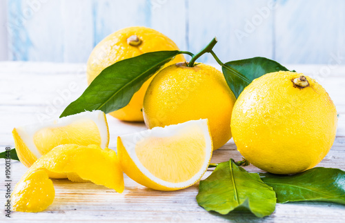 Fresh bergamot citrus fruits from Reggio Calabria Italy on white wood background.