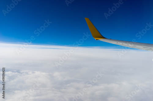 Poster Afrique du Sud Clouds and wing, view from the window of airplane flying in the clouds