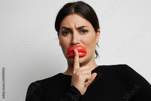 Fotobehang womenART Close up portrait of woman with fake botox lips. White background