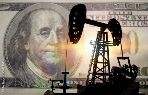Fototapeta Concept oil and dollar. Installation for drilling a pump oil against a background of one hundred dollars a banknote, money. business and finance, extraction obraz