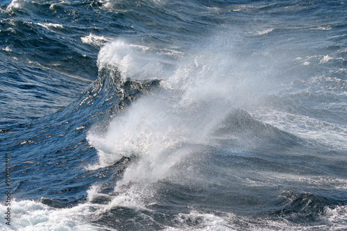 Blue ocean wave on Windy Rough sea day. Cruise ship Vacation. Big surf.