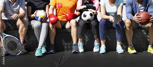Group of diverse athletes sitting together - 190038643