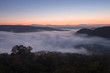 Misty landscape view of Phu pha nong in morning with beautiful twilight sky in Loei, Thailand