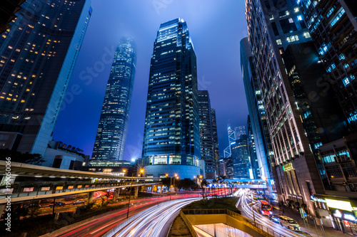 Poster Tokyo Hong Kong Central Business District at Night with Light Track
