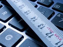 Tape Measurer On Laptop Keyboa...